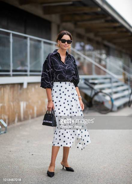 Funda Christophersen wearing white skirt with dots print is seen outside JLindeberg during the Copenhagen Fashion Week Spring/Summer 2019 on August 8...