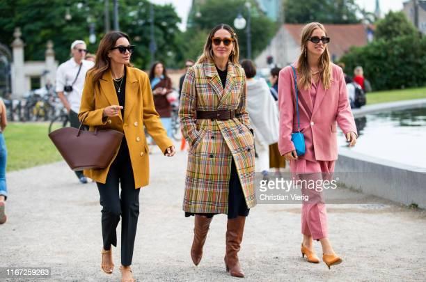 Funda Christophersen wearing yellow blazer brown triangle bag Tiany Kiriloff wearing plaid belted coat and Trine Kjaer wearing pink suit seen outside...