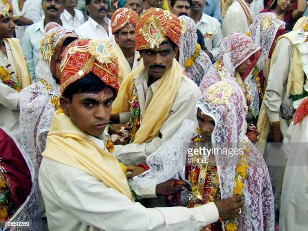 In this picture taken 30 April 2006 Indian youth Sharadha Prasad and his bride to be Kumla Baiof take part with others in a mass wedding ceremony...