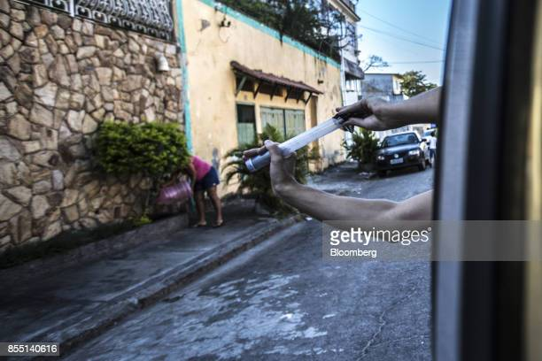 A Fundacao Oswaldo Cruz worker releases mosquitoes infected with the Wolbachia bacteria in an attempt to control the diseasecarrying female Aedes...