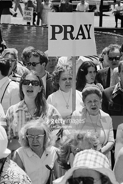 A fundamentalist Christian who is a follower of Reverend Carl McIntyre holds a sign that reads Pray during an Honor America demonstration at...