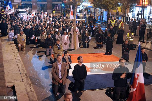 Fundamentalist Christians kneel as they pray on November 19 2011 in the southwestern city of Toulouse during a protest outside the Garonne Theatre...