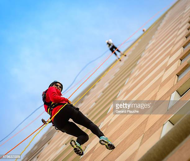 CONTENT] Fundraiser for Louisiana Special Olympics People scaling office building in an event called Over the Edge