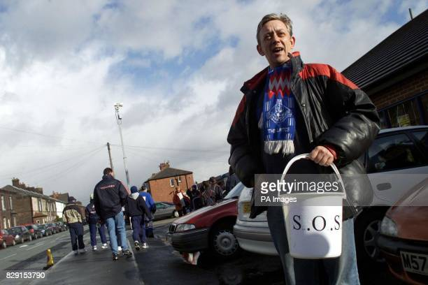 Fundraisers outside Gigg Lane attempt to save Bury FC ahead of their side's Nationwide Division Two match against Bournemouth which could be their...