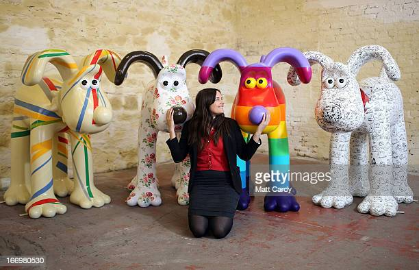 Fundraising manager Lauren Vincent poses with four Gromit sculptures out of around 70 which have been painted by celebrity artists Sir Paul Smith...