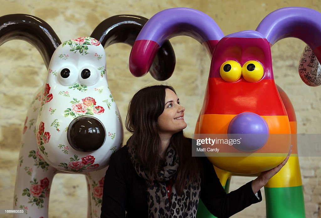 Fundraising manager Lauren Vincent poses with four Gromit sculptures, out of around 70 which have been painted by celebrity artists, (L-R) Cath Kidston and Richard Williams before they are placed around the city for public view as part of charity initiative arts trail, on April 19, 2013 in Bristol, England. After being displayed to the public from July 1, the sculptures will be eventually auctioned off to raise funds for the Bristol Children's Hospital charity, Wallace & Gromit's Grand Appeal.