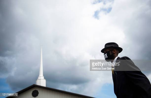 A funeral attendant helps direct traffic outside of a public viewing for George Floyd on June 6 2020 in Fayetteville North Carolina George Floyd died...