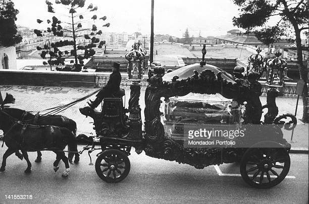 A funeral carriage transporting Lucky Luciano's coffin Naples 26th January 1962
