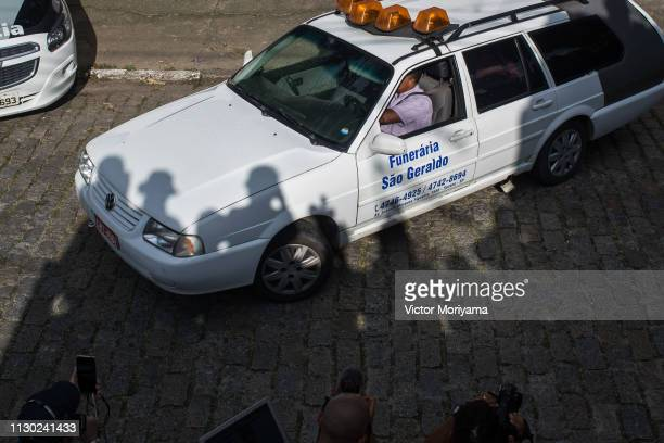 Funeral cars carrying bodies leave the public school where two students opened fire March 13, 2019 in Suzano, Brazil. Eight people were killed and...
