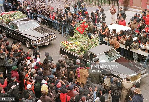 Funeral cars filled with floral tributes to rapper Biggie Smalls pass down St James Place the street in Brooklyn where his mother lives 18 March in a...