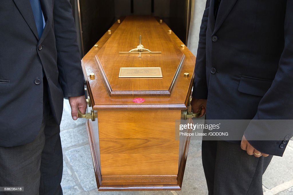 Funeral. Coffin carriers. : Stock Photo