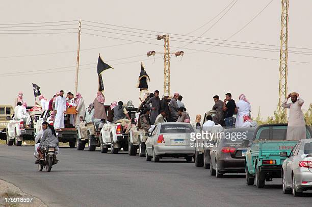 A funeral convoy carrying the bodies of four Egyptian militants drives through the small Sinai village of Sheikh Zuweid and several border towns in...