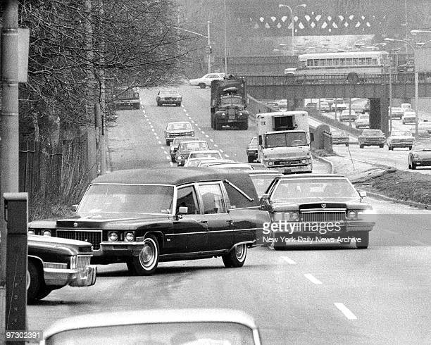 Funeral cortege of Frank Costello hardly disturbs traffic as hearse turns into St Michael's Cemetery Astoria Queens Costello who died Sunday at 82...