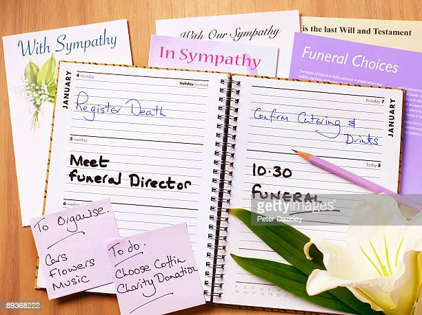 funeral diary open. - funeral stock pictures, royalty-free photos & images