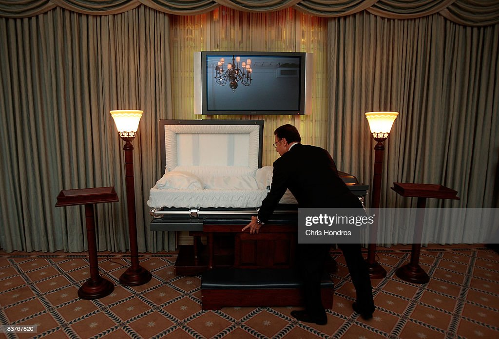 Funeral director Peter DeLuca, owner of Greenwich Village Funeral Home looks over a casket in his funeral parlor on November 20, 2008 in New York City. New technologies, such as flat screen televisions for video memorials, are also slowly being introduced at funeral homes. Despite the currently languishing economy, the funeral home world is readying for an upswing nationally, as the recession-resistant business prepares for an expected rise in death rates as baby boomers start to reach old age in the coming decade.