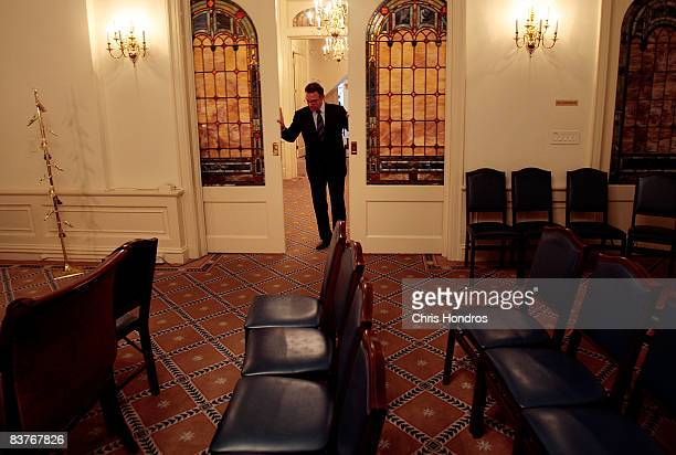 Funeral director Peter DeLuca owner of Greenwich Village Funeral Home closes sliding doors in his funeral parlor on November 20 2008 in New York City...