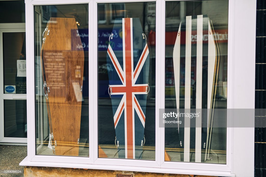 A funeral directors store displays coffins featuring different designs, including one in the style of a Union flag, also known as the Union Jack, in Wallsend, U.K., on Thursday, Sept. 6, 2018. The northeast of England illustrates the precarious position facing many parts of the U.K. just six months before the country is due to leave the EU. Photographer: Matthew Lloyd/Bloomberg via Getty Images