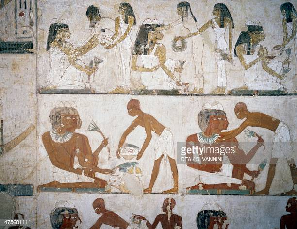 Funeral feast with female musicians women putting on jewellery men and musicians detail from the frescoes in the Tomb of Rekhmire Sheikh Abd el...