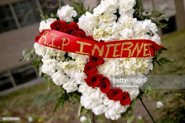 A funeral flower arrangement is set up outside the Federal Communication Commission building during protest against the end of net neutrality rules...