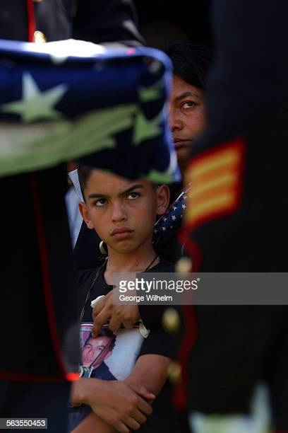 4/12/2003 – Funeral for Marine private Francisco A Martinez Flores killed in Iraq Martinez's younger brother Sammy left and mother Martha Martinez...