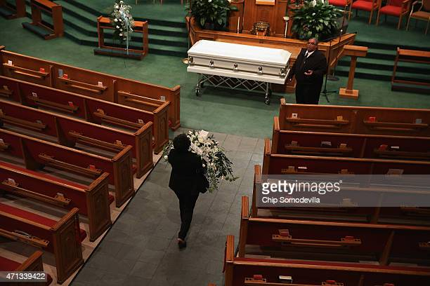Funeral home employees prepare for Freddie Gray's funeral service inside the New Shiloh Baptist Church during his funeral April 27, 2015 in...