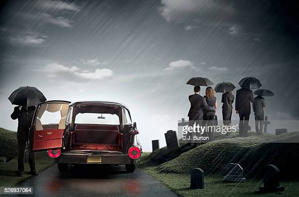 funeral in rain - hearse stock pictures, royalty-free photos & images