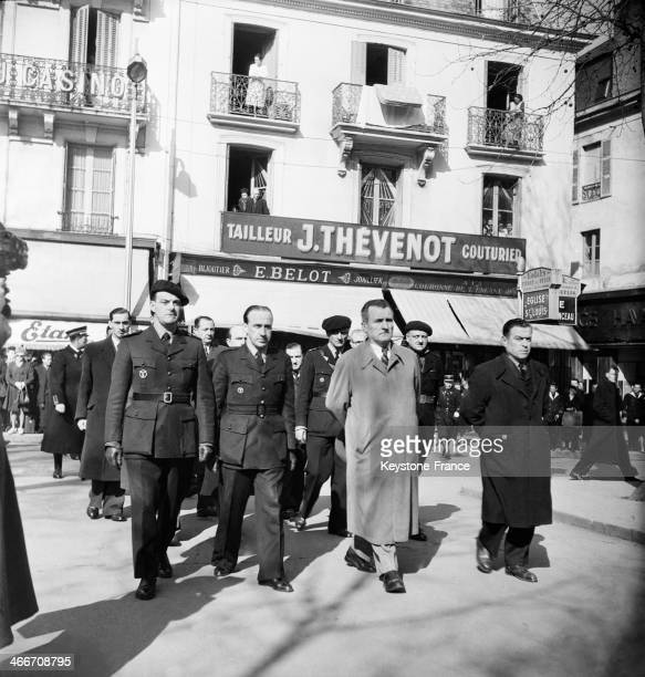 Funeral of a franc garde of the Milice Richard Van Herreweghe attended by Lucien Raymond Clemoz M Bout de l An Joseph Darnand and Francois Labade...