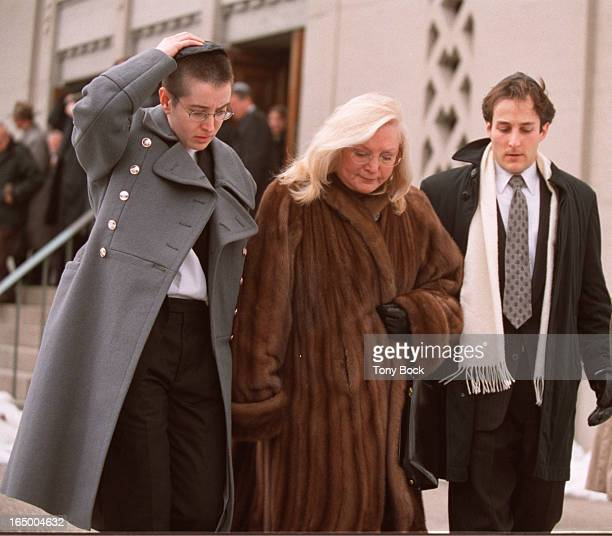 Funeral of Al Waxman family leave synagogue wife Sara blond centre with daughter Tobaron left grey coat and son Adam TONY BOCK/TORONTO STAR