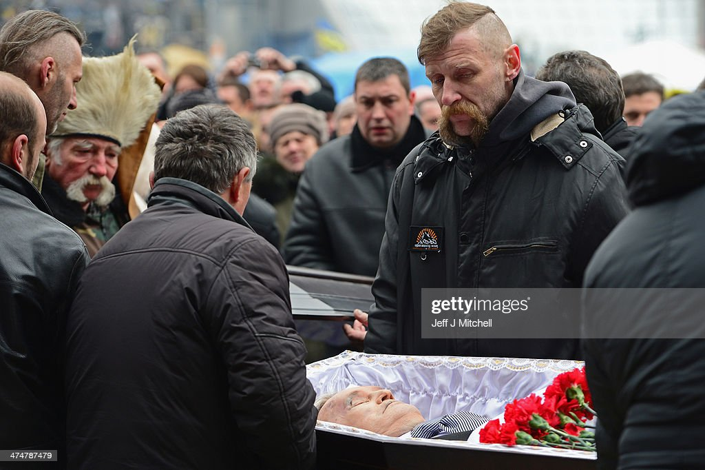 A funeral of an anti-government demonstrator takes place Independence square, where dozens of protester were killed in clashes with riot police last week on February 25, 2014 in Kiev, Ukraine. Ukraine's interim President Olexander Turchynov is due to form a unity government, as UK and US foreign ministers meet to discuss emergency financial assistance for the country.