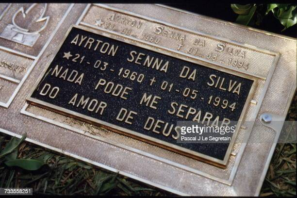 Funeral of Brazilian triple Formula One World Champion Ayrton Senna at the Morumbi cemetery Senna's grave with the inscription Nothing can separate...