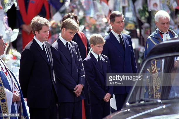 Funeral of Diana Princess of Wales LR Earl Spencer Prince Charles Prince William Harry and Prince Charles stand alongside the hearse containing the...
