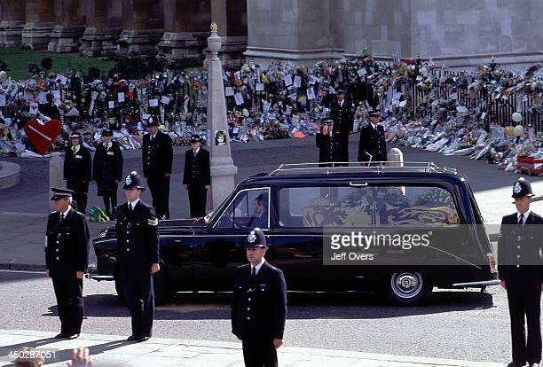 Funeral of Diana Princess of Wales The hearse containing the coffin of Diana leaves Westminster Abbey after the funeral service Policemen stand...