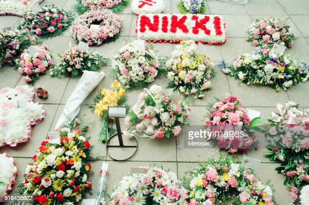 Funeral of schoolgirl Nikki Conroy Tuesday 5th April 1994 Condolence flowers outside School