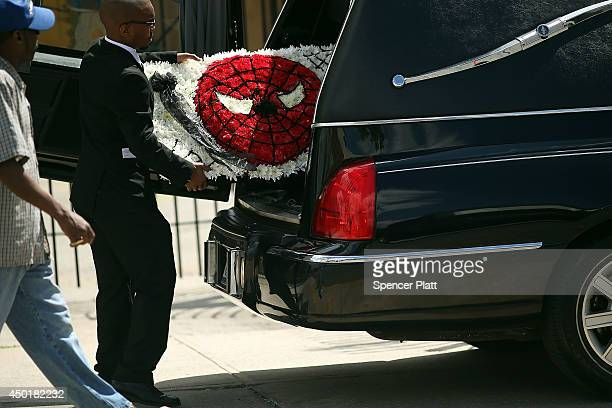 A funeral parlor employee places a a Supermanthemed bouquet inside of a hearse at the conclusion of the funeral for 6yearold Prince Joshua Avitto at...