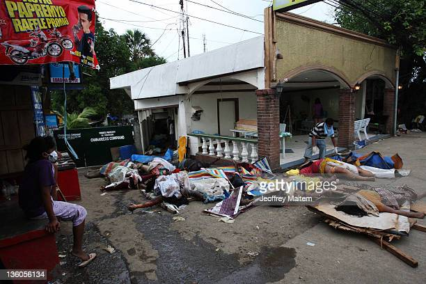 A funeral parlor worker tends to the dead bodies of storm victims on December 18 2011 in Cagayan de Oro Philippines Typhoon Washi a tropical storm...