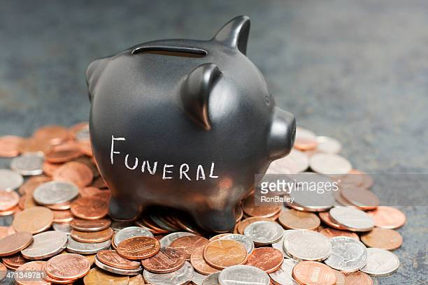 """funeral"" piggy bank on coins - funeral stock pictures, royalty-free photos & images"