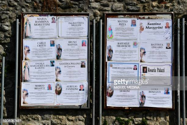 Funeral posters are displayed in the village of Vertova near Bergamo, Lombardy, on March 24 where 36 people died of coronavirus in 23 days.