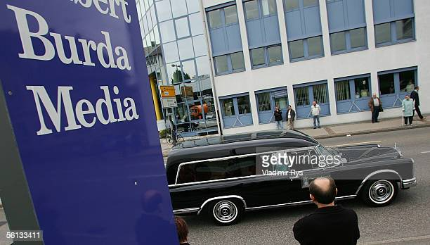 A funeral procession containing the body of Aenne Burda passes the Burda publishing house after the funeral service on November 10 2005 in Offenburg...