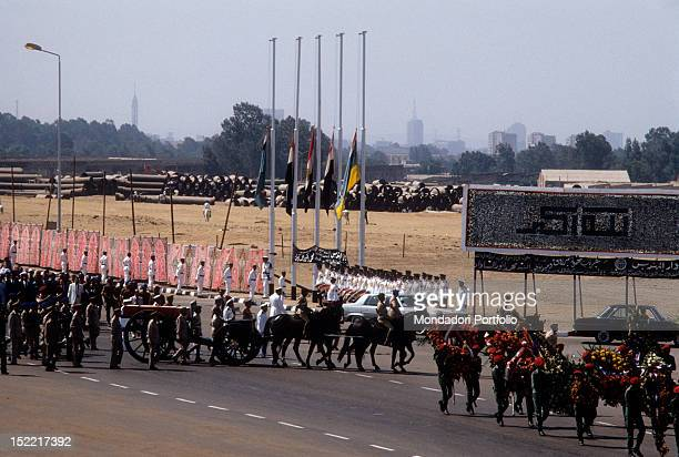 Funeral procession for Sadat Egyptian President the grave is wrap on the flag and carried on a carriage cannon drawn by horses Medinet Nasr