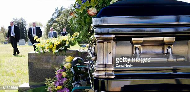 funeral procession in cemetery. - coffin stock pictures, royalty-free photos & images