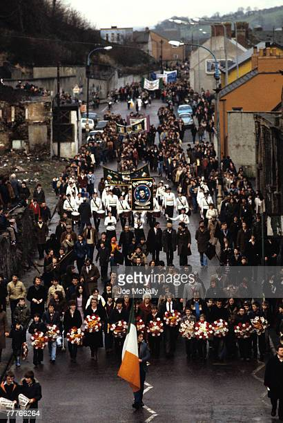 A funeral procession marches in honor of Bobby Sands in May of 1981 in the street in Northern Ireland Bobby Sands an active member of the Irish...
