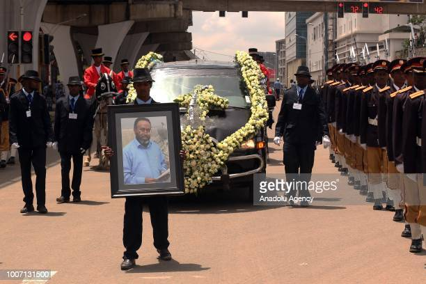 Funeral procession takes place while transporting the coffin of Engineer Simegnew Bekele the project manager for a hydroelectric dam since its...