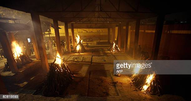 Funeral Pyres for six of the victims of the New Delhi bomb blasts are lit at a crematorium in New Delhi on September 14, 2008. Indian police hunted...
