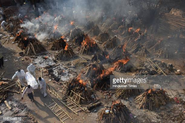 Funeral pyres of people who died of Covid-19 burning simultaneously at Gazipur crematorium on April 26, 2021 in New Delhi, India. India has...