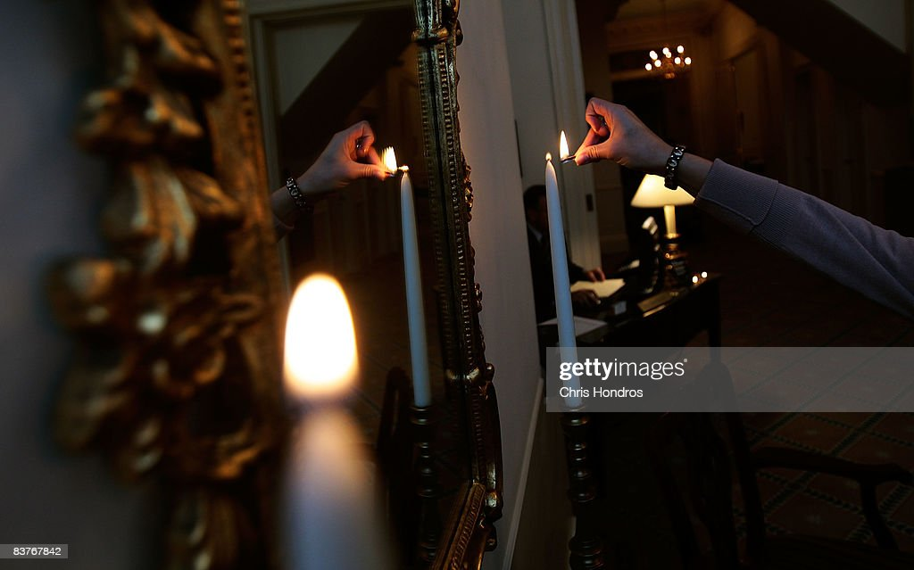 Funeral resident in training, Jennifer Greenberg lights candles in the foyer of her workplace at the Greenwich Village Funeral Home on November 20, 2008 in New York City. Despite the currently languishing economy, the funeral home world is preparing for an upswing nationally, as the recession-resistant business prepares for an expected rise in death rates as baby boomers start to reach old age in the coming decade.