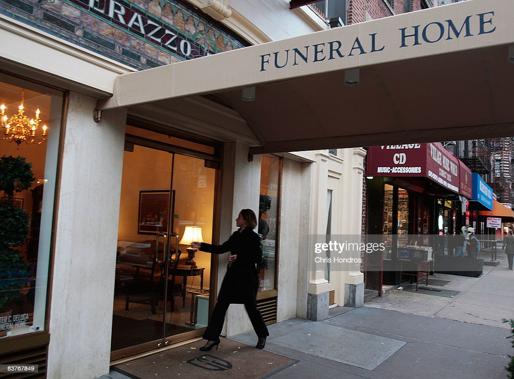 Funeral resident Jennifer Greenberg walks into her workplace at the Greenwich Village Funeral Home on November 20, 2008 in New York City. Despite the currently languishing economy, the funeral home world is preparing for an upswing nationally, as the recession-resistant business prepares for an expected rise in death rates as baby boomers start to reach old age in the coming decade.