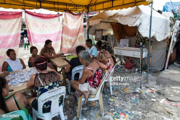 CEMETERY NAVOTAS MANILA PHILIPPINES Funeral scene seen in the navotas cemetery slum In the center of Pasay District of Metro Manila is a cemetery...