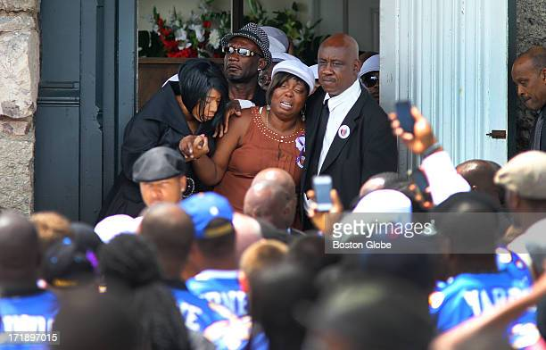 Funeral service was held for Odin Lloyd at the Holy Spirit Church in Mattapan. His mother, Ursula Ward, is helped after the service by his sister...