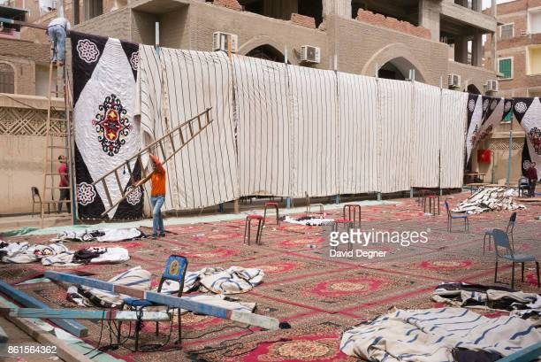 A funeral tent is reerected in the courtyard after another victim died of his wounds at the Mar Girgis church where a bomb exploded during Palm...
