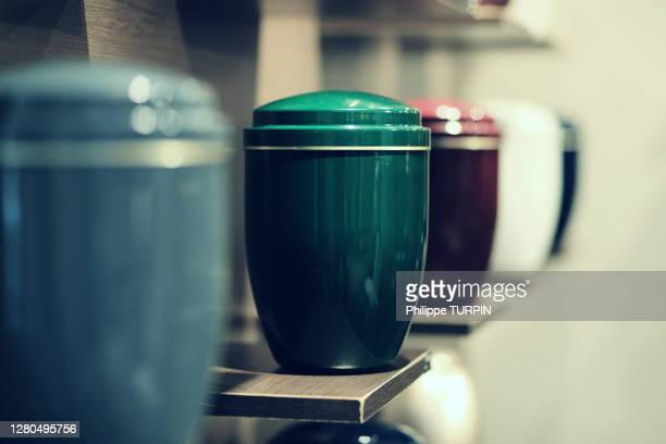 funeral urns aligned - urn stock pictures, royalty-free photos & images